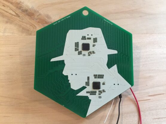 Green PCB with white silhouette and SMT components on it