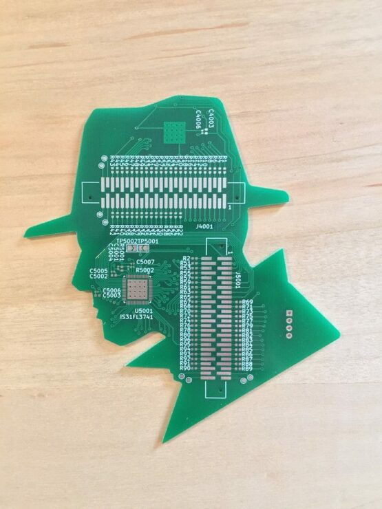 Green PCB cut out in the shape of a head/silhouette